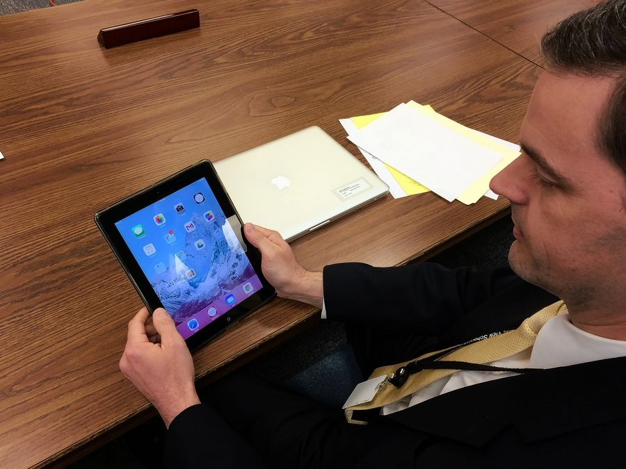 District 103 Superintendent Scott Warren demonstrates one of the iPads that first-graders at Sprague School will use this fall.