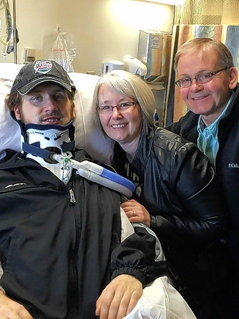 In one of the first public photos released since his injury, hockey player Matt Olson is joined at his hospital bedside by his parents, Sue and Doug Olson. Matt Olson suffered a severe spinal cord injury during a Feb. 21 game at the Sears Centre Arena in Hoffman Estates.