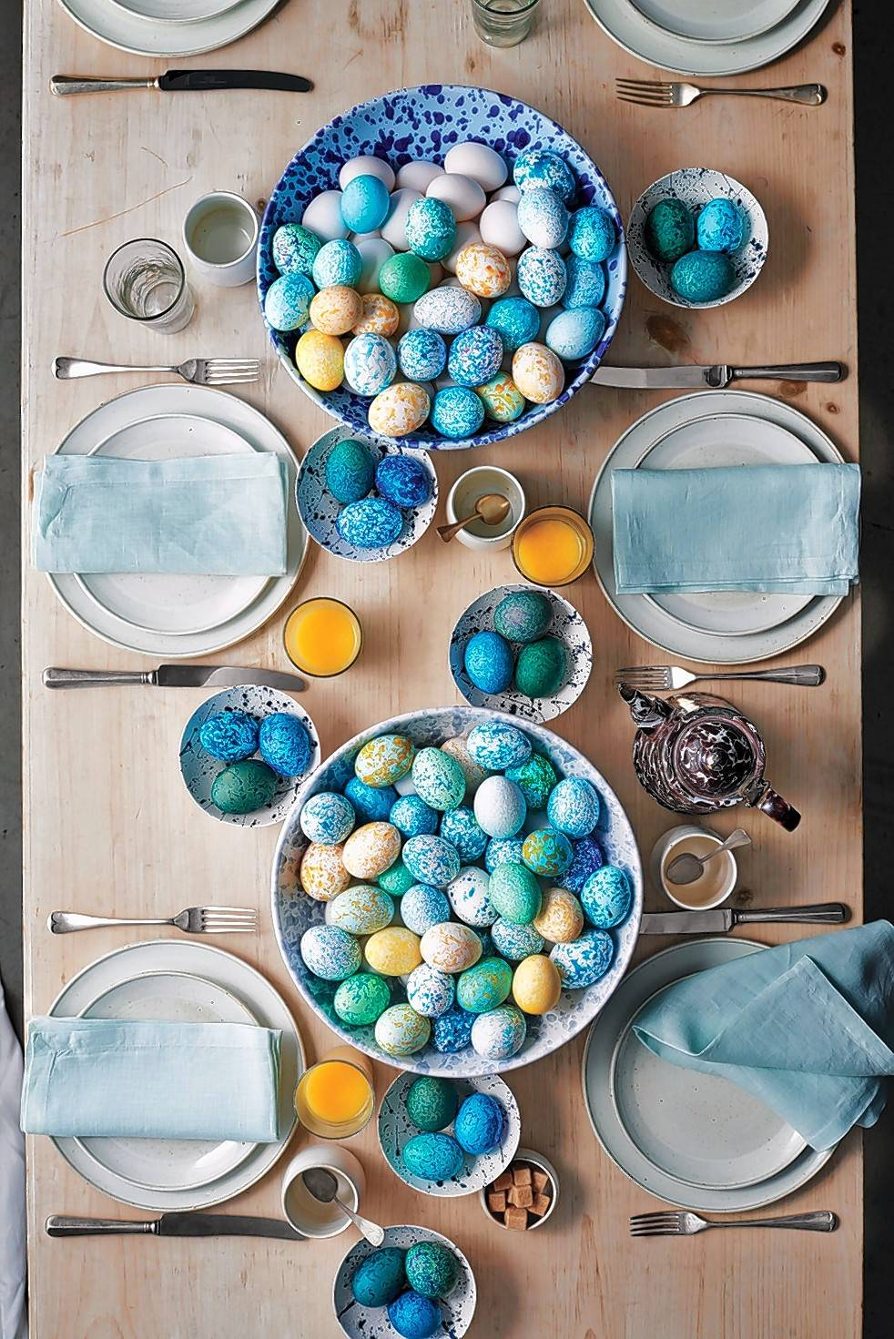 A speckled egg table setting featured in the March issue of Martha Stewart Living shows off & Martha Stewart on Easter paper napkins and serving takeout