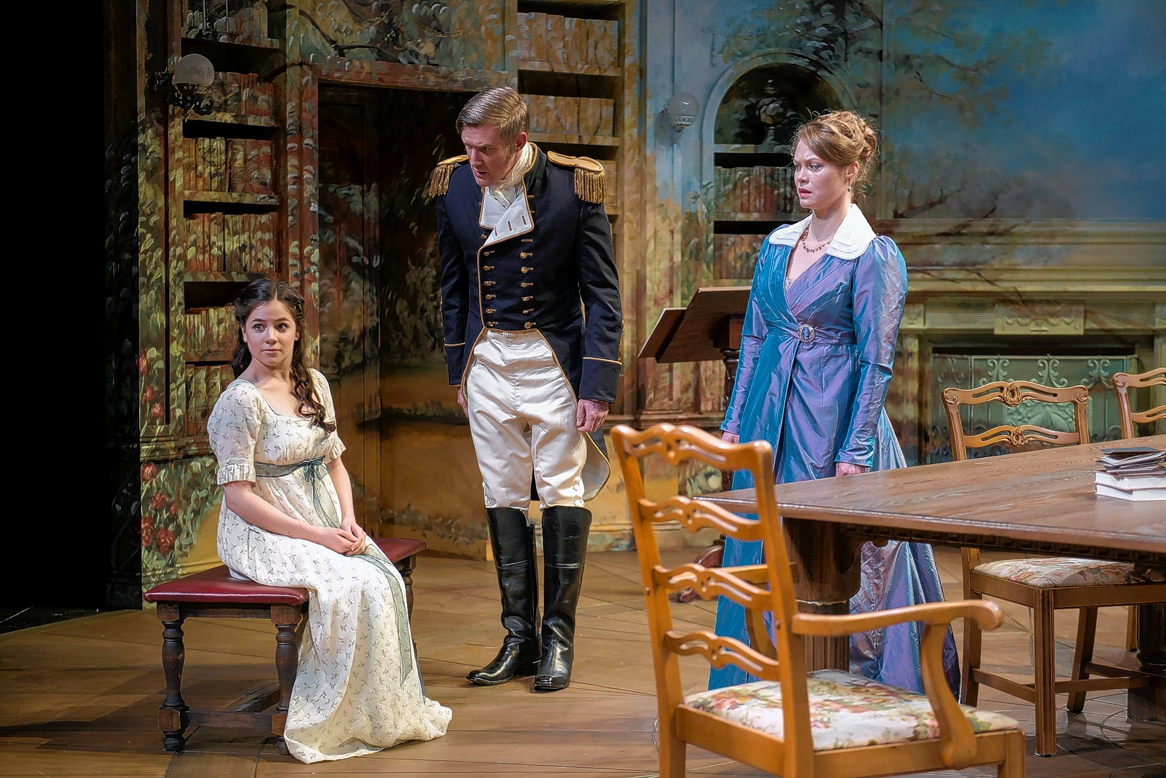"Capt. Brice (Nathan Hosner) questions his niece Thomasina (Elizabeth Stenholt), left, while Thomasina's mother (Chaon Cross) looks on in ""Arcadia,"" Tom Stoppard's time-jumping tale of sexual attraction and math in a revival at Writers Theatre."