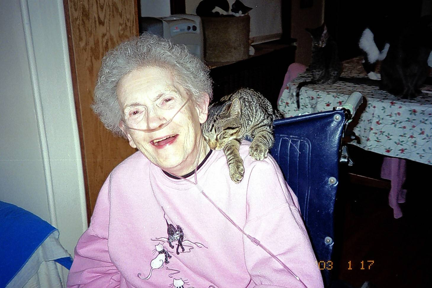 A former Touched By An Animal client is all smiles when getting a visit from Amorous.