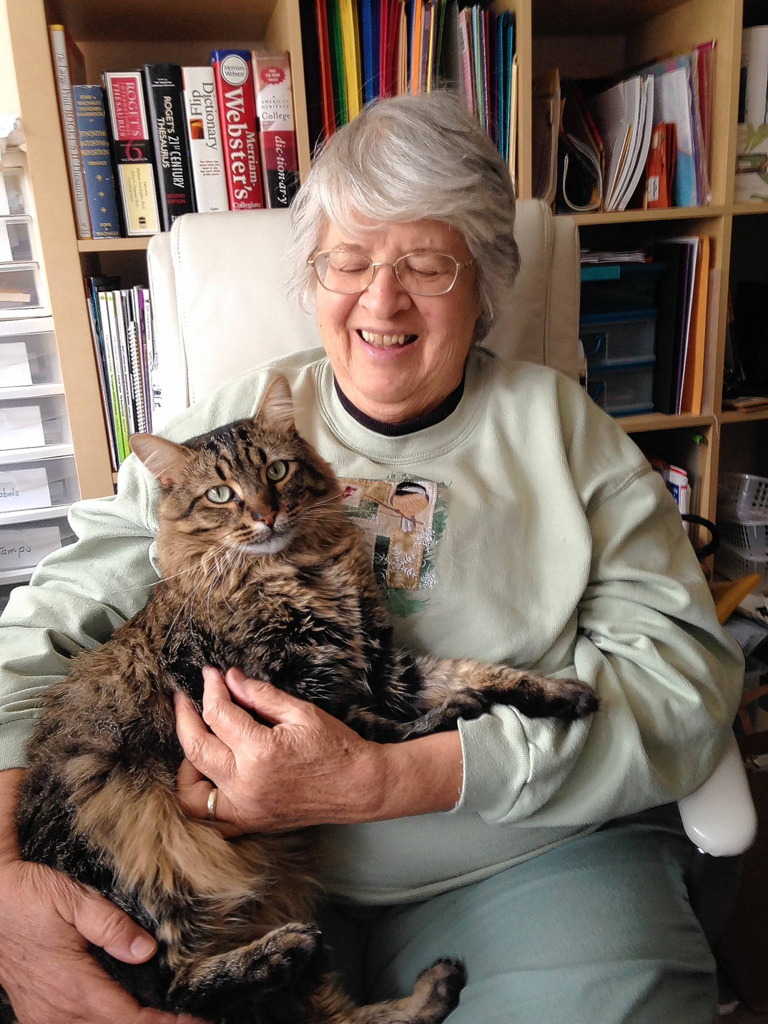 Marijon Binder founded Touched By An Animal more than 30 years ago when several of her neighbors began having health problems. They resisted moving into assisted living housing because they worried about leaving their pets. Binder has adopted her office cat, Milkshake, which was rescued by the organization.