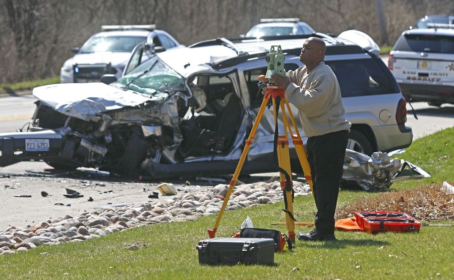 A member of the Kane County Accident Reconstruction team investigates a single fatality accident Tuesday on Route 31 near Mooseheart Child City and School.