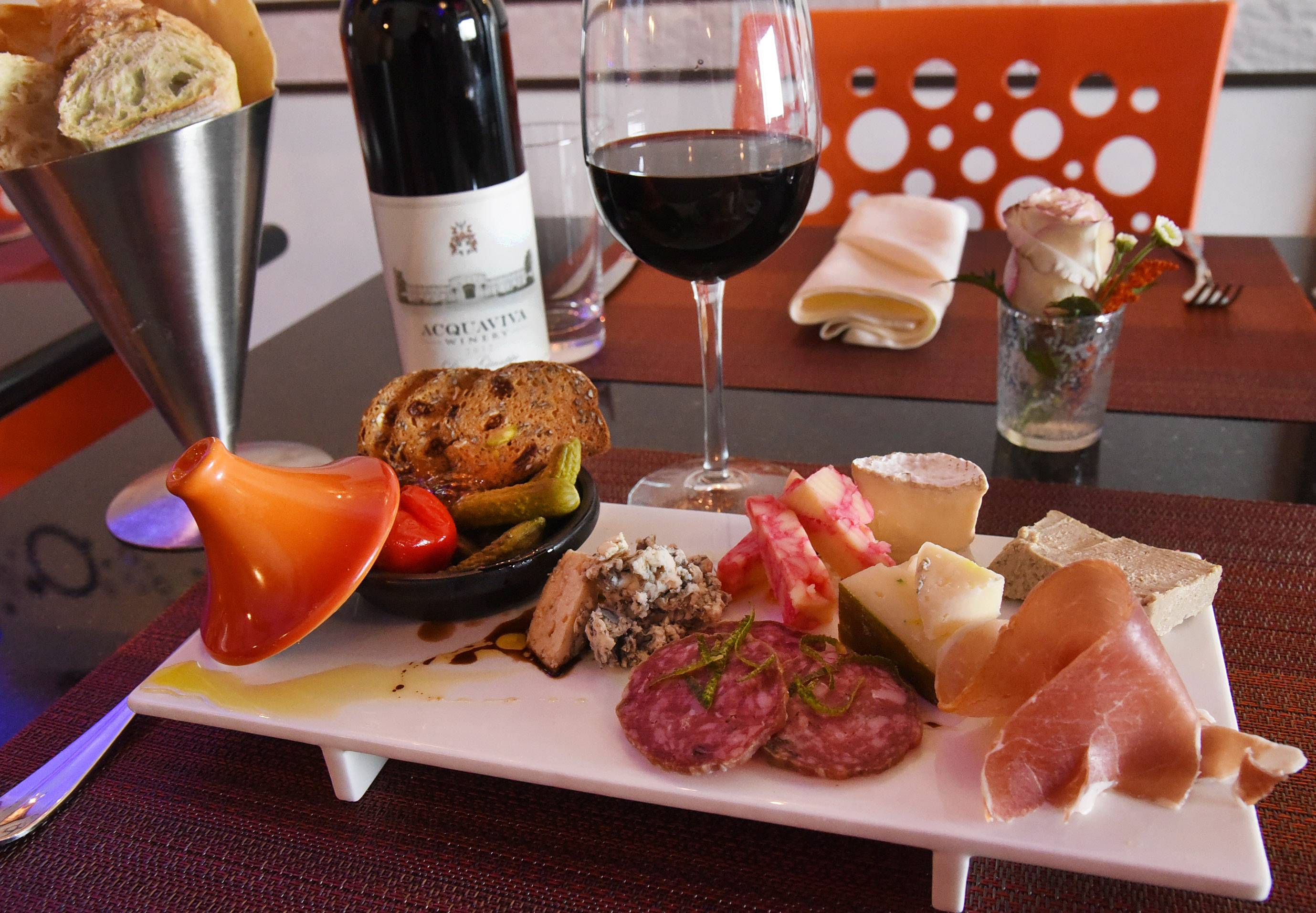 A cheese plate at Primo in Geneva might include a semi-firm cheese from Ludwig Farmstead, Bleu d'Auvergne and Gres Champenois. Add to that assorted charcuterie dishes, liver pate from France, bite-size cornichons and Aquaviva Pinot Noir and you have a meal.