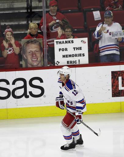 New York Rangers  Eric Staal skates past fans during warm-ups for an NHL 9eac97a0f