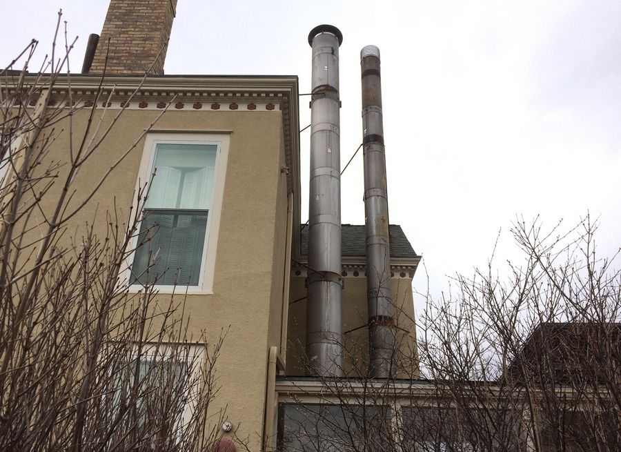 The unused and obsolete concrete incinerator vents attached to the landmark Cook House in downtown Libertyville will be demolished.