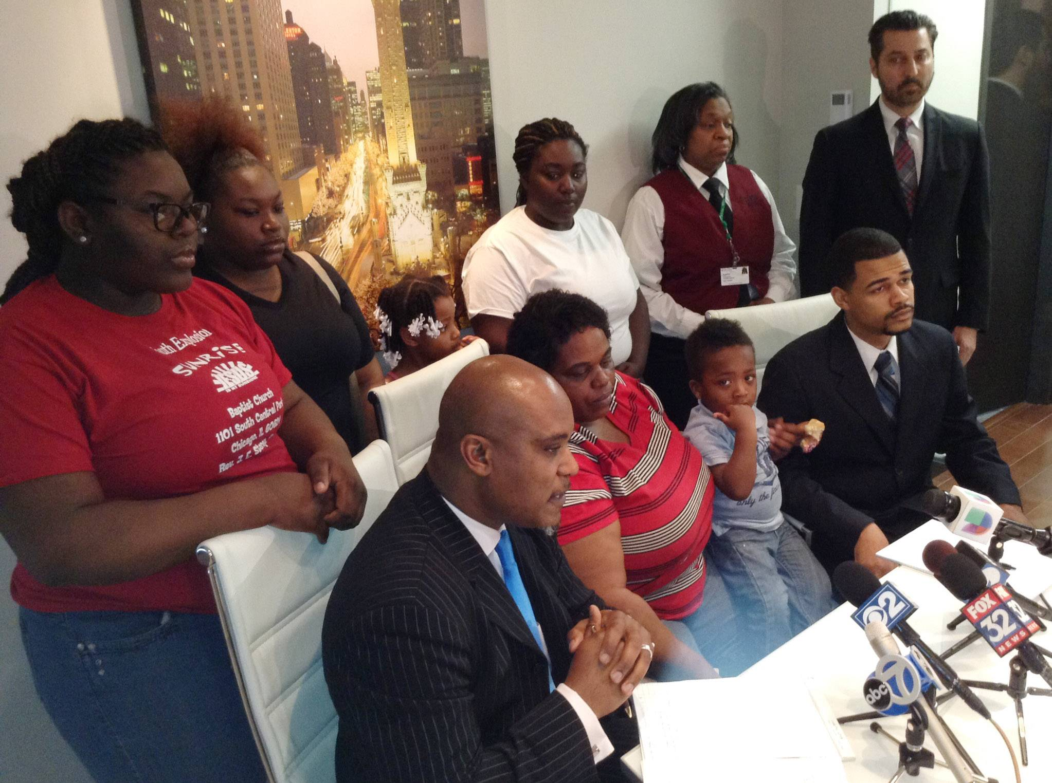 Attorney Cannon Lambert Sr., seated left, is joined by the family of Shaquan Allen Friday at a Chicago news conference. Shaquan's mother, Willie Mae, said she's seeking answers to her son's death.