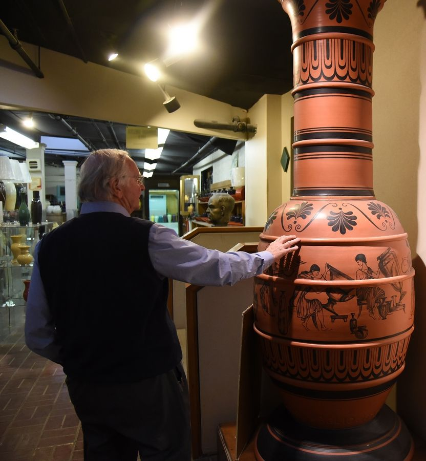 Craig Zachrich, chief operating officer of Haeger Potteries, shows off what was once the world's largest hand-thrown pot.