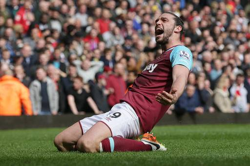 West Ham's Andy Carroll celebrates after scoring his team's second goal during the English Premier League soccer match between West Ham United and Arsenal at Upton Park stadium in London, Saturday April 9, 2016. (AP Photo/Tim Ireland)