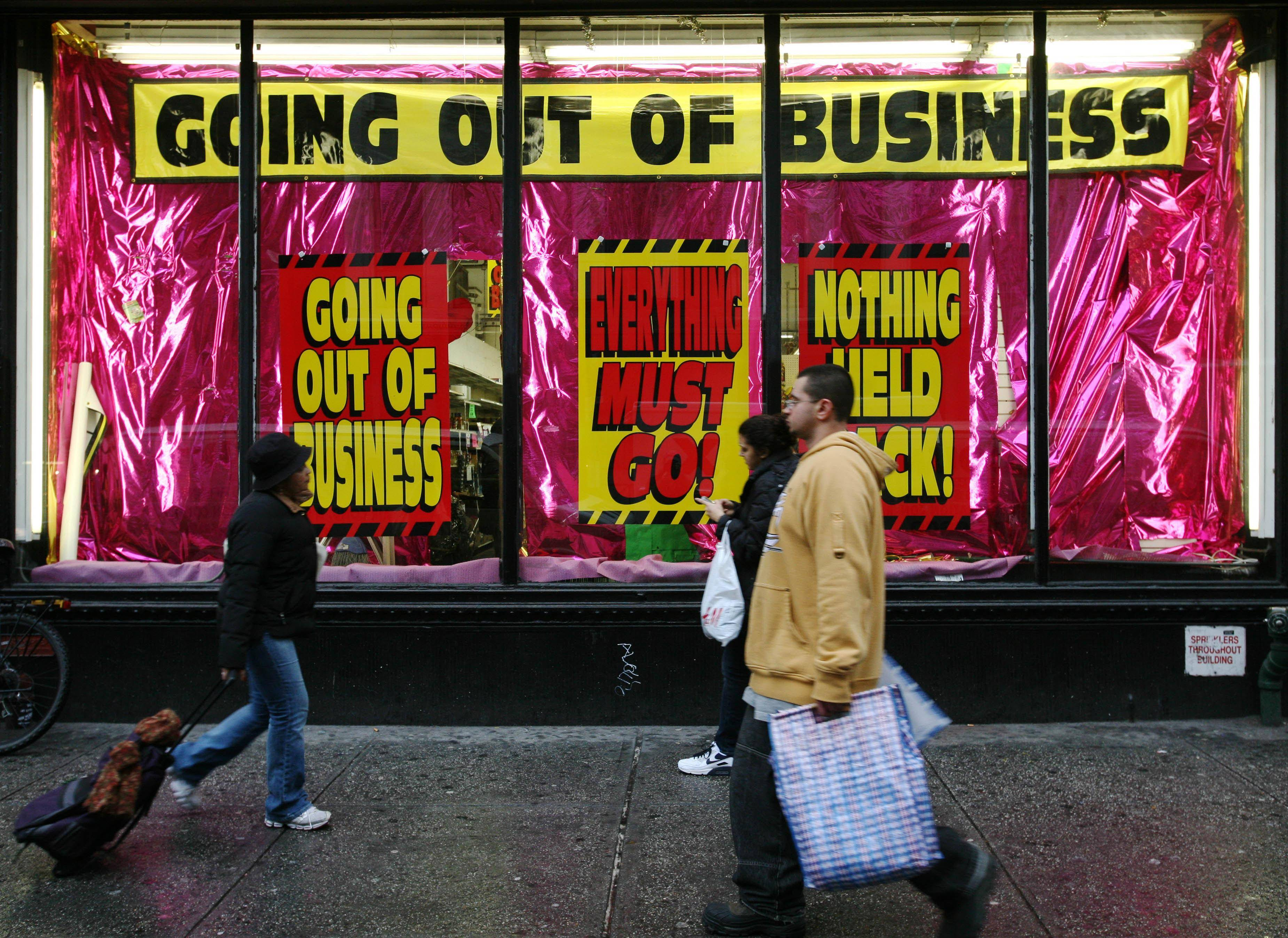 A store advertises that it is going out of business in December 2008. Between 2000 and 2007, borrowed money was adding about $330 billion a year to Americans' purchasing power, according to the Federal Reserve Bank of New York. By 2009, households were diverting $150 billion to pay back debt -- a swing of almost half a trillion dollars, even without counting the impact of lost jobs.