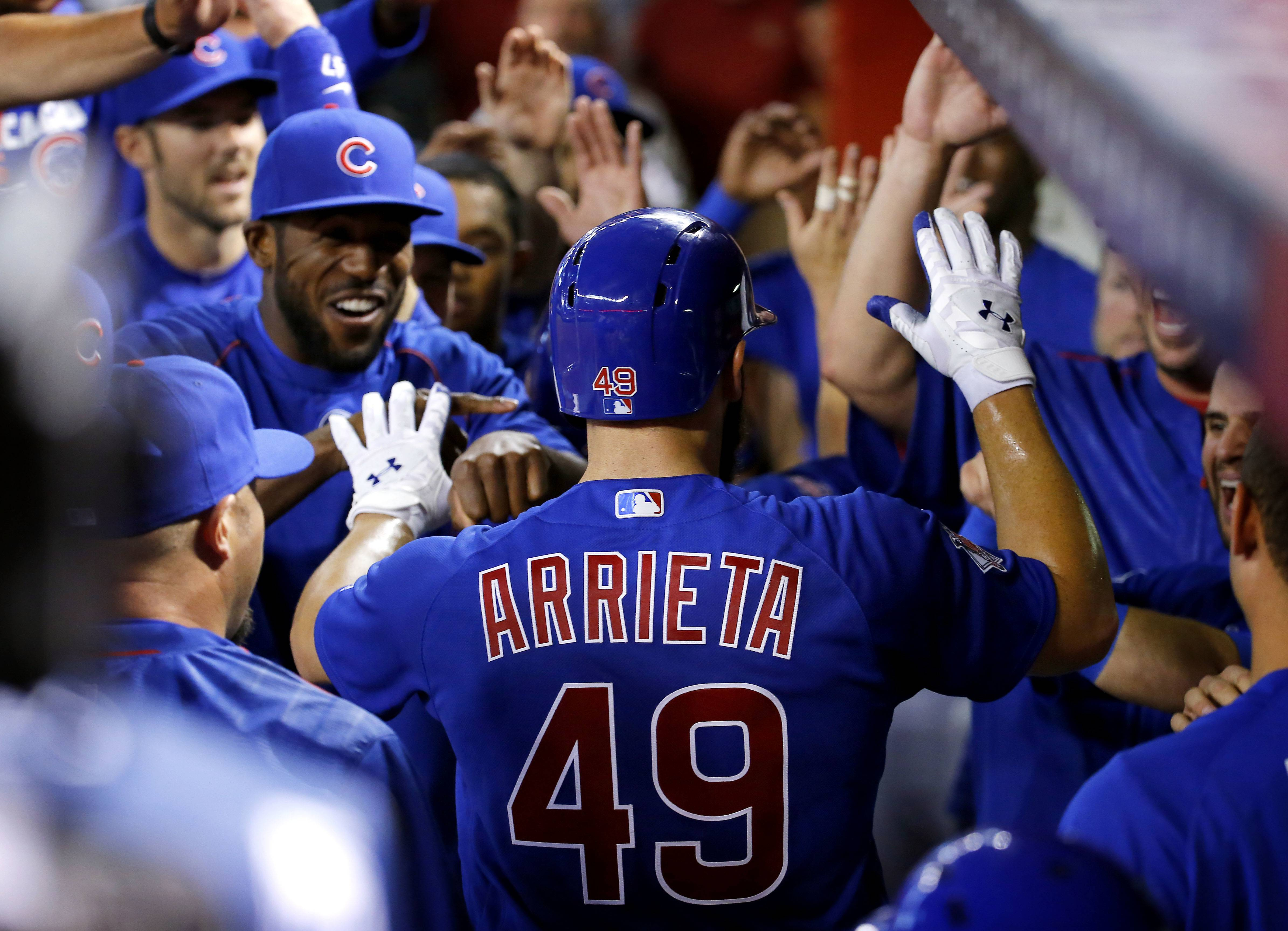 Arrieta homers, pitches 7 innings to lead Cubs over Arizona