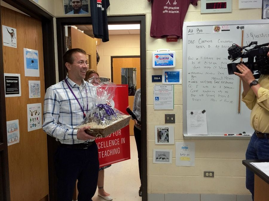 """There was no inkling that this was going to happen today for me,"" said Jeff Grant, a Downers Grove North High School teacher who was surprised with a Golden Apple award Monday."