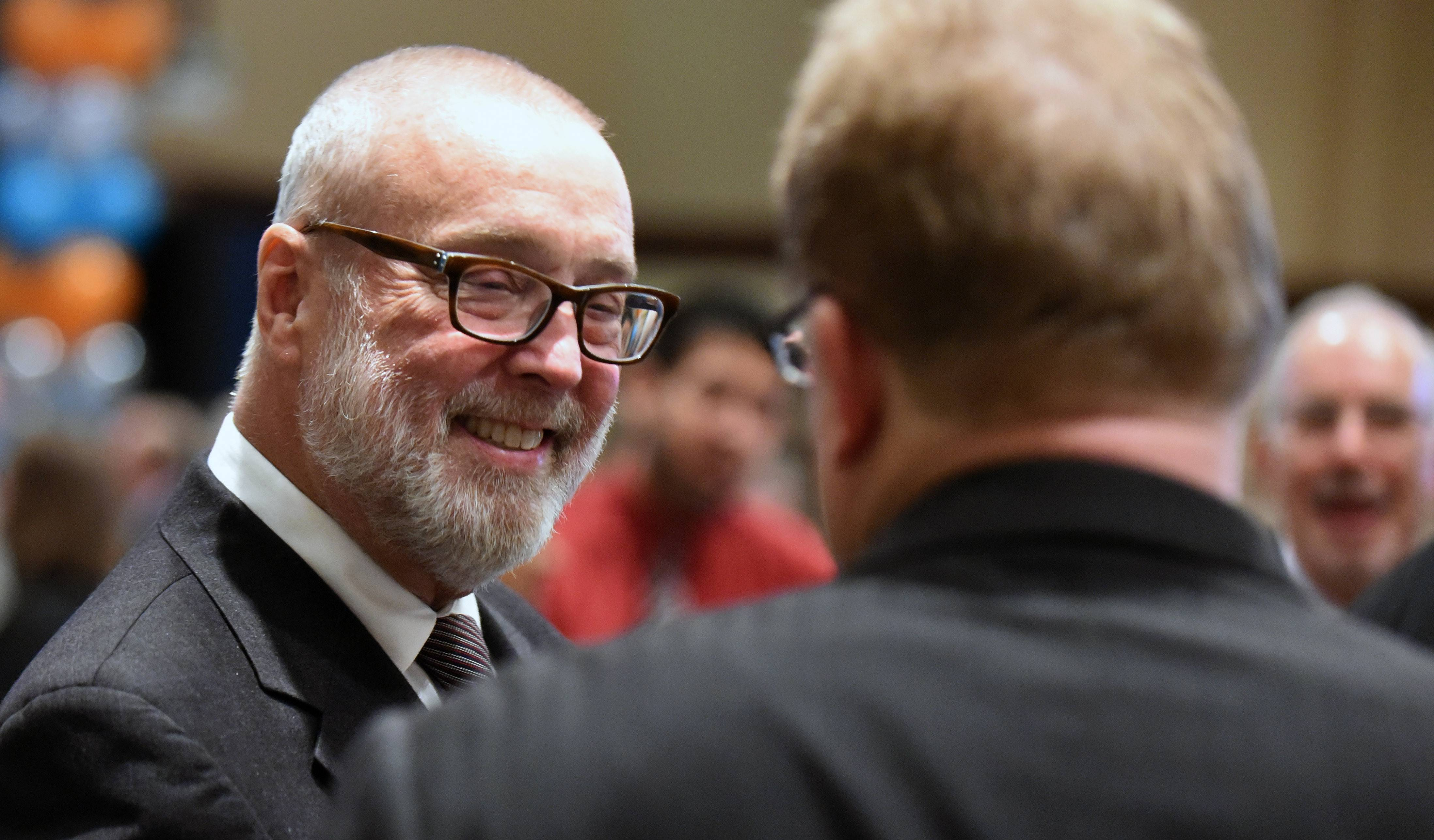 Aurora Mayor Tom Weisner speaks with John Clark of Cordogan, Clark & Associates Inc. of Aurora after giving his final state-of-the-city address Thursday at Pipers Banquets.
