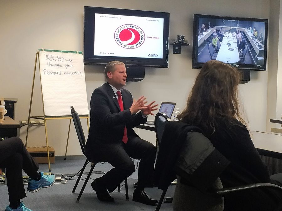 "District 214 Superintendent David R. Schuler presents ""Redefining Ready!"" to the Illinois State Board of Education Wednesday morning."