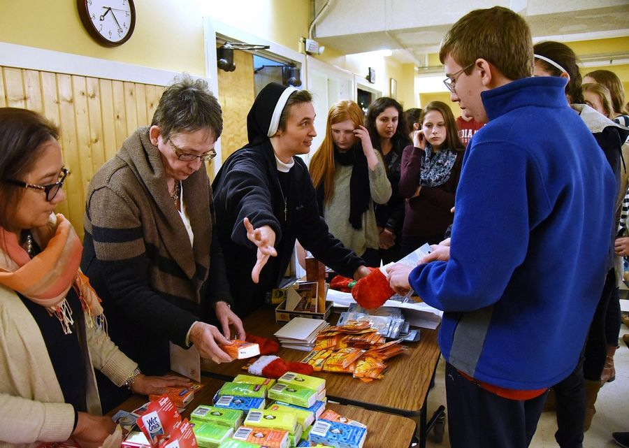Sister Faustina Ferko and her youth ministry members prepare gift bags for the homeless shelter at St. James Parish in Arlington Heights.