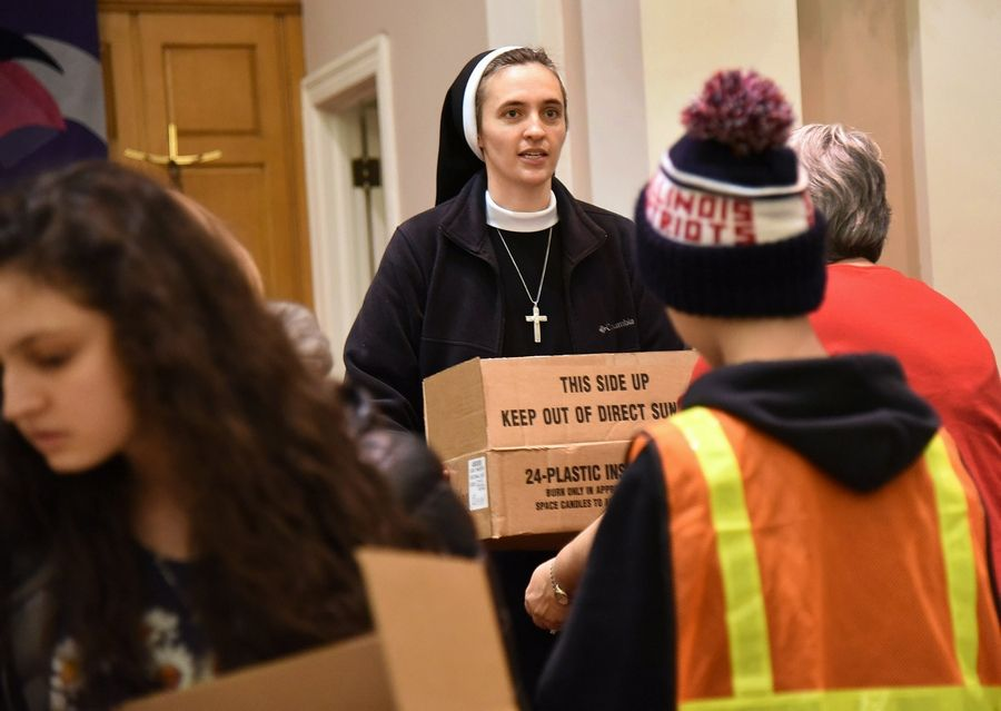 Sister Faustina Ferko is always on the move as she works with kids in her youth ministry group at St. James Parish in Arlington Heights.