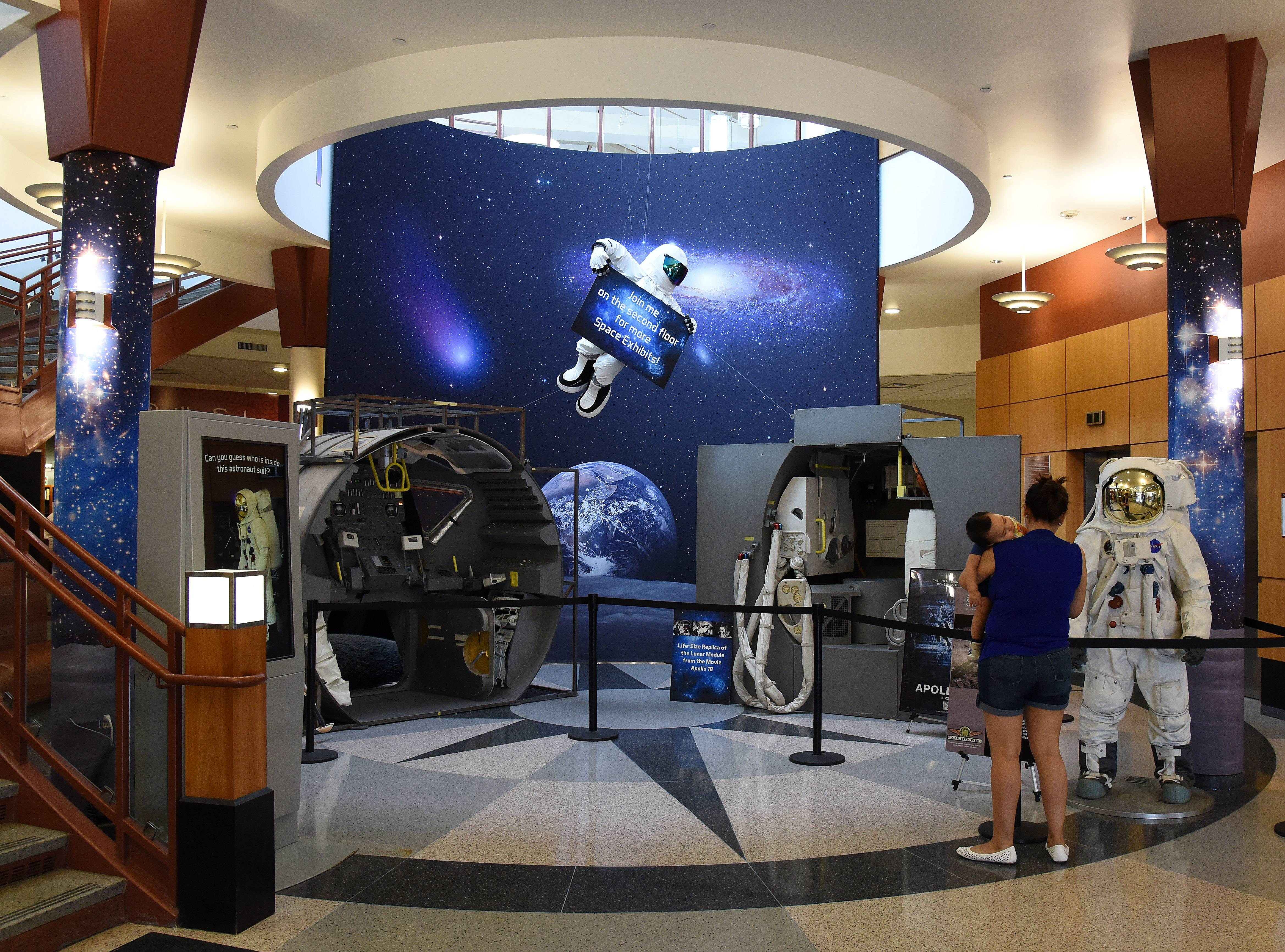 The lobby of the Gail Borden Library is transformed into Discover Space: A Cosmic Journey. The exhibit is on display in Elgin until July 5.