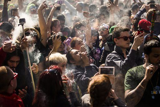 "People gather to smoke marijuana during the ""420 Toronto"" rally in Toronto on Wednesday, April 20, 2016. Cannabis possession is illegal in most countries under a 1925 treaty called the International Opium Convention. But just like the U.S., some nations either flout the treaty or don't enforce it. Legalization supporters consider pot possession either legal or tolerated in Argentina, Bangladesh, Cambodia, Canada, Chile, Colombia, the Czech Republic, India, Jamaica, Jordan, Mexico, Portugal, Spain, Uruguay, Germany and the Netherlands. (Mark Blinch/The Canadian Press via AP) MANDATORY CREDIT"