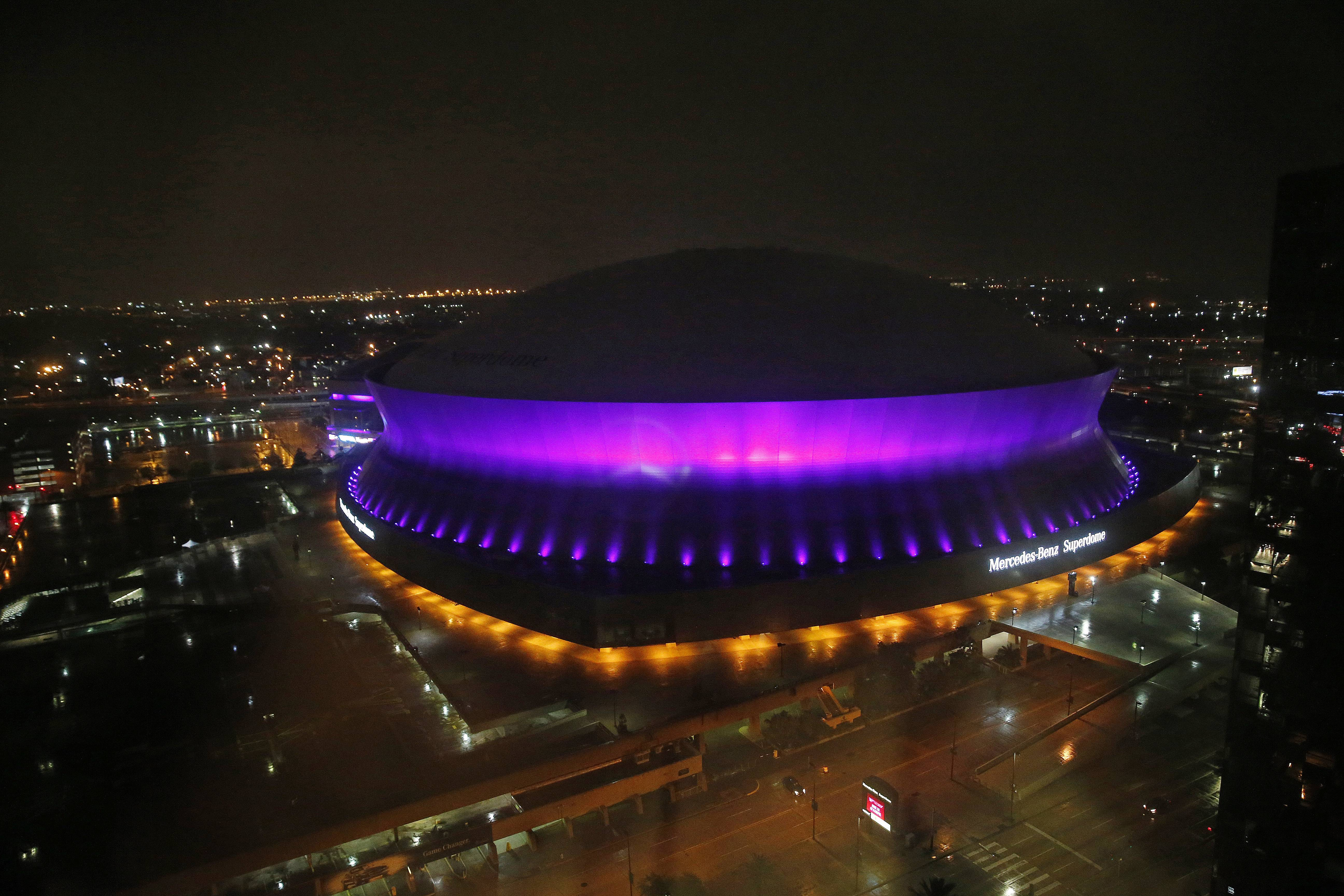 The Mercedes-Benz Superdome is lit up in the color purple in New Orleans, Thursday, April 21, 2016, to honor pop legend Prince, who died today.
