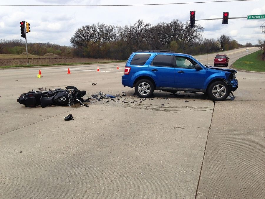 A collision Thursday afternoon at Bartlett Road and Route 59 in Bartlett left a 20-year-old motorcyclist with life-threatening injuries.