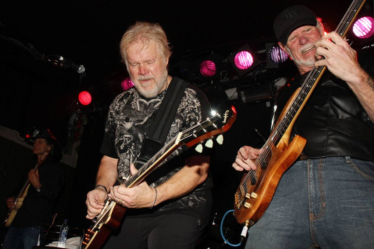 Randy Bachman, left, and Fred Turner of Bachman Turner Overdrive jam during a performance.