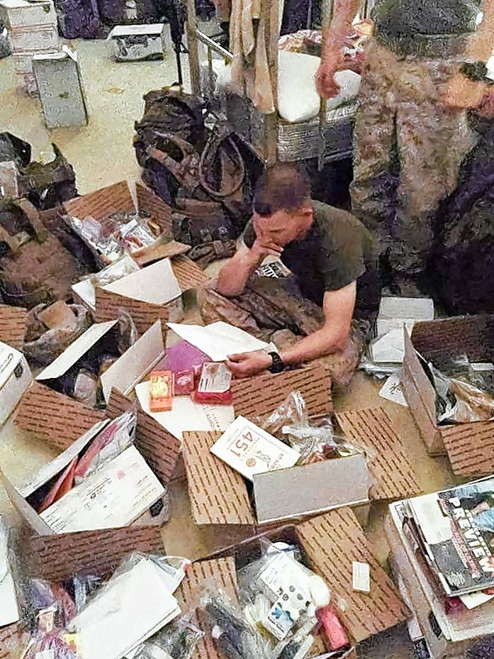 Military personnel overseas dive into the comfort boxes.