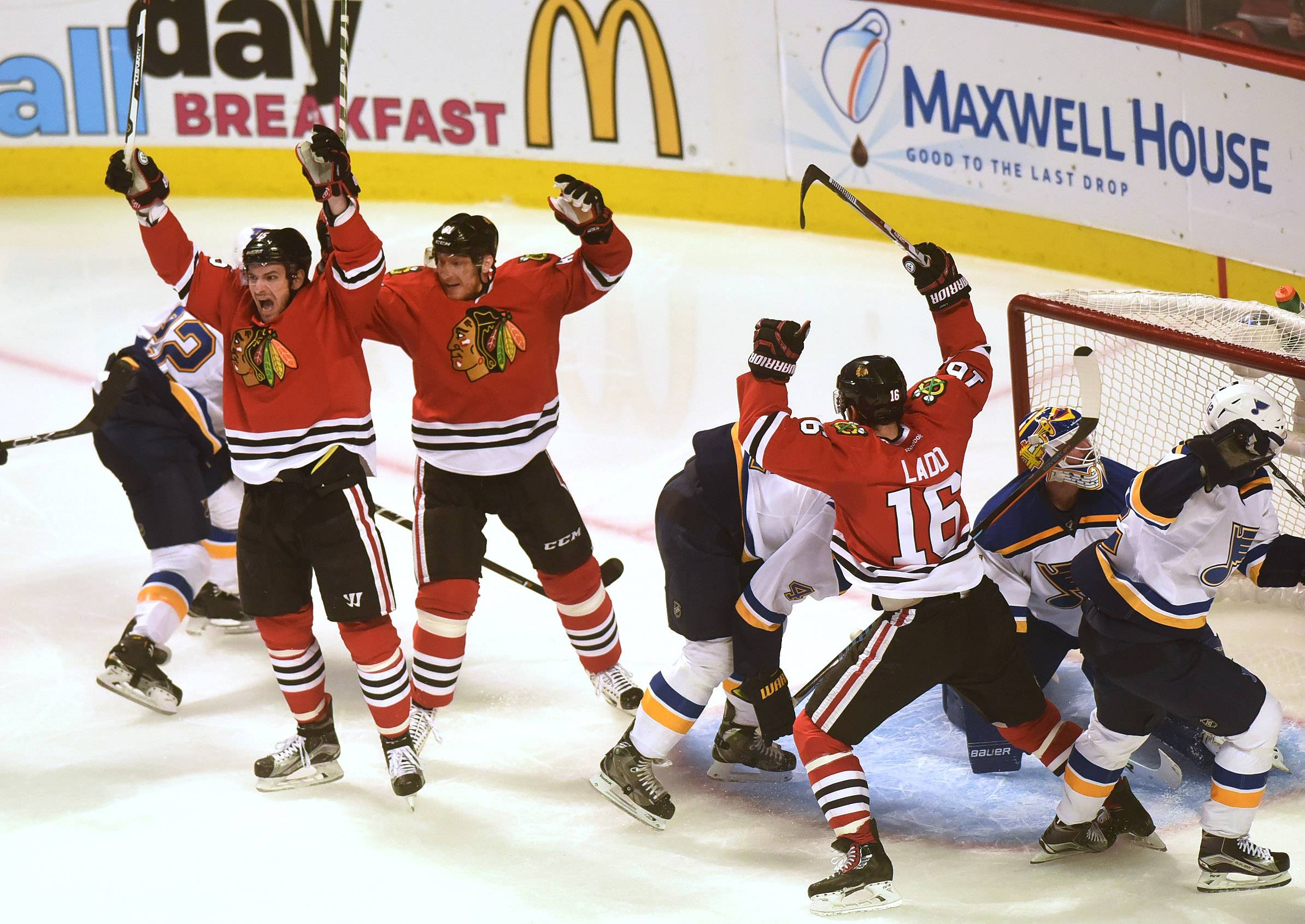 Chicago Blackhawks center Artem Anisimov (15), left, Chicago Blackhawks right wing Marian Hossa (81), center, and Chicago Blackhawks left wing Andrew Ladd (16) celebrate Anismov's 2nd period goal between the Chicago Blackhawks and the St. Louis Blues.