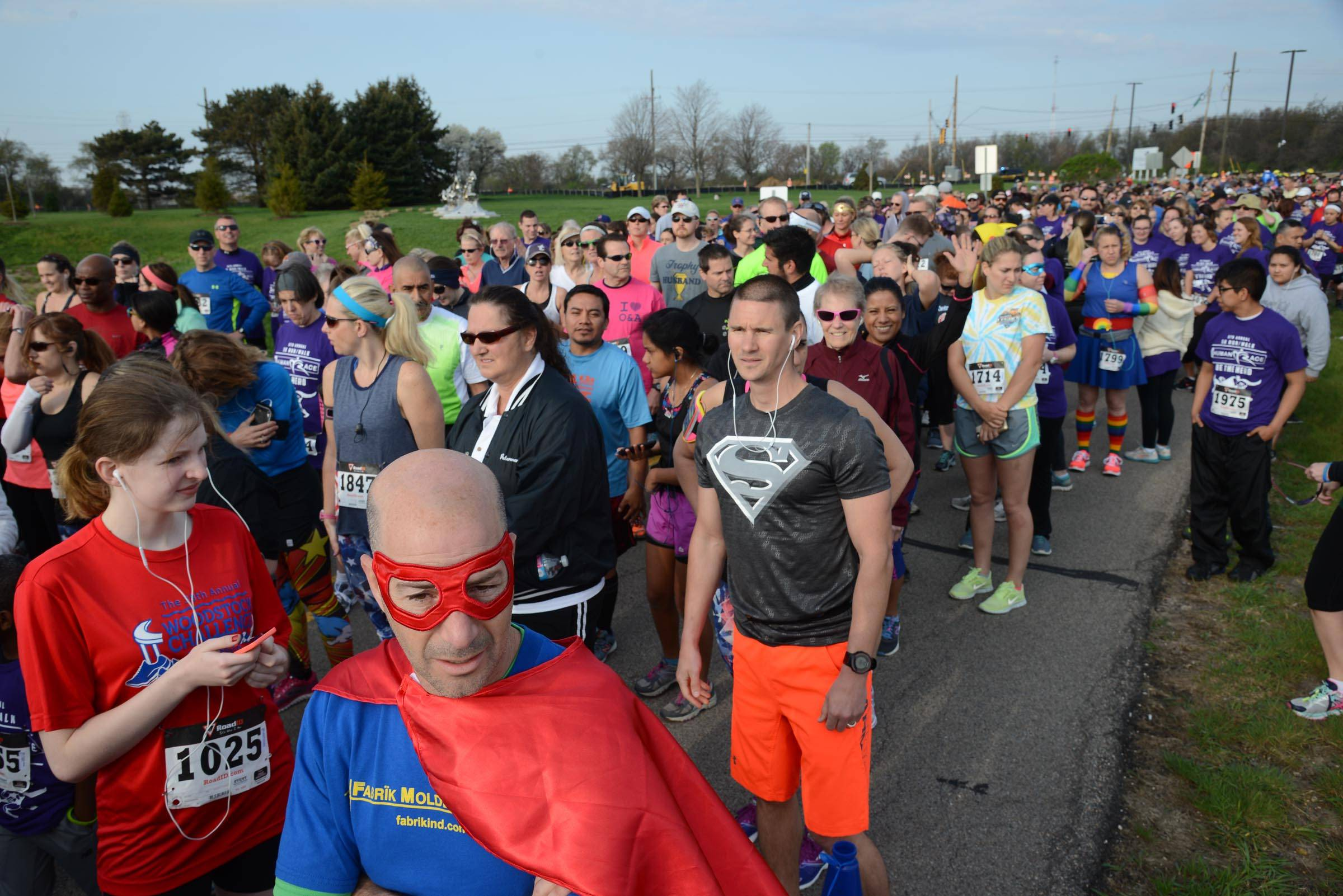Many of the thousands who walked and ran Sunday in the McHenry County Human Race 5K in Crystal Lake came dressed as superheroes. Participants chose from among 67 charities their registration fee would benefit.