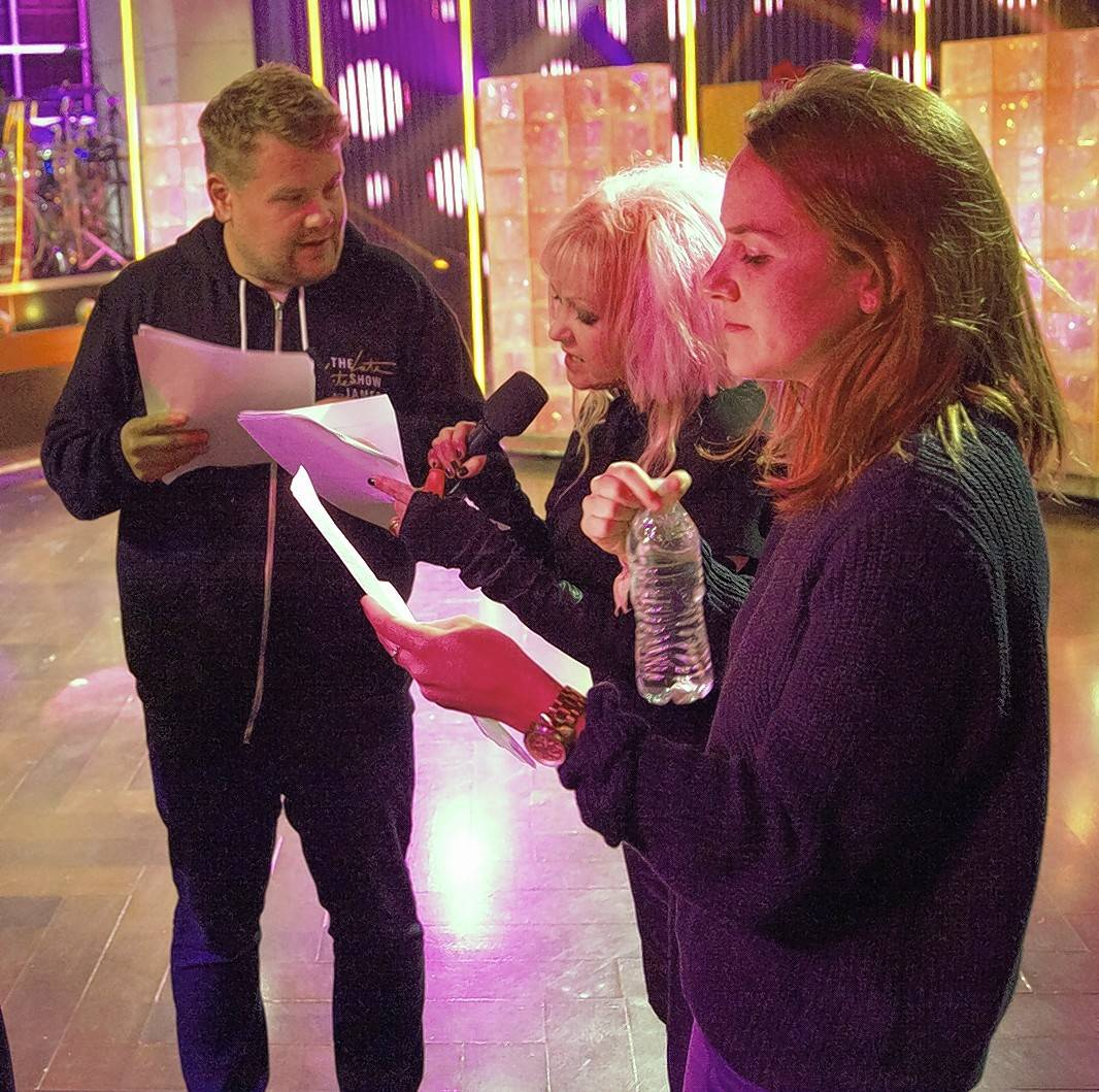 "Arlington Heights native Kate Presutti, right, the comedy producer on ""The Late, Late Show with James Corden,"" goes over a show segment with Corden and guest Cyndi Lauper."
