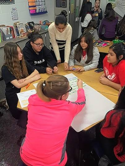Some of the members of the service club at Holmes Junior High School in Mount Prospect discuss plans for donating supplies to a local homeless shelter. From left, Christina Patras, Sofia Castro, Kamika Patel, Shala Garcia, Kelly Tejeda, Melissa Hernandez and Anna Nyzhnyk.