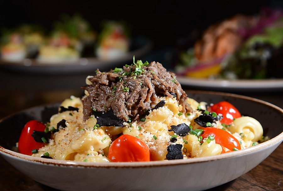Pork belly can be added to The Burger Local's homemade mac and cheese to make a hearty meal.