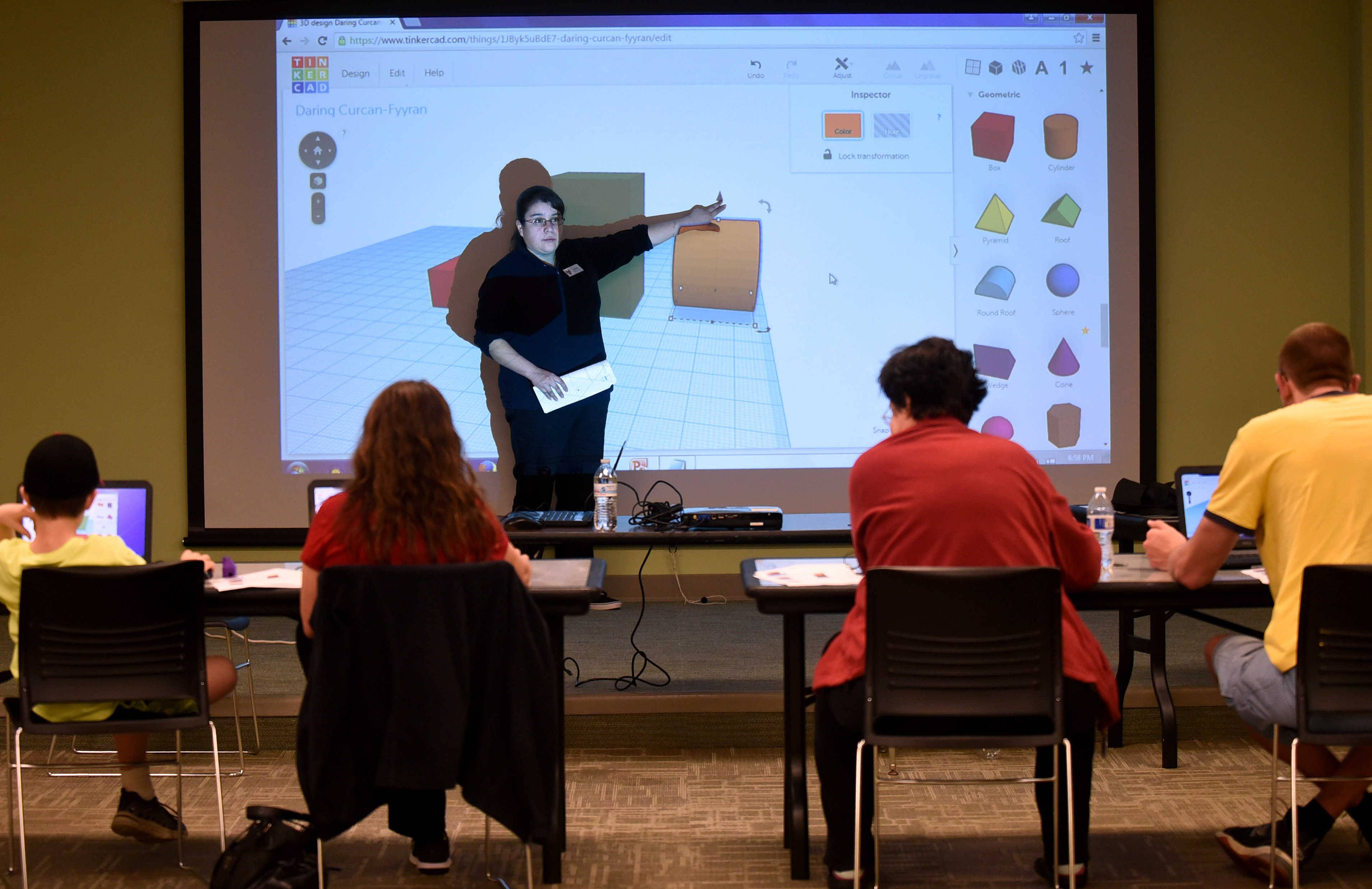 Bilingual digital services assistant Erica Acevedo delivers a lesson on 3-D printing Monday at Dundee Library in East Dundee. It's part of an increased effort to provide services requested by patrons.