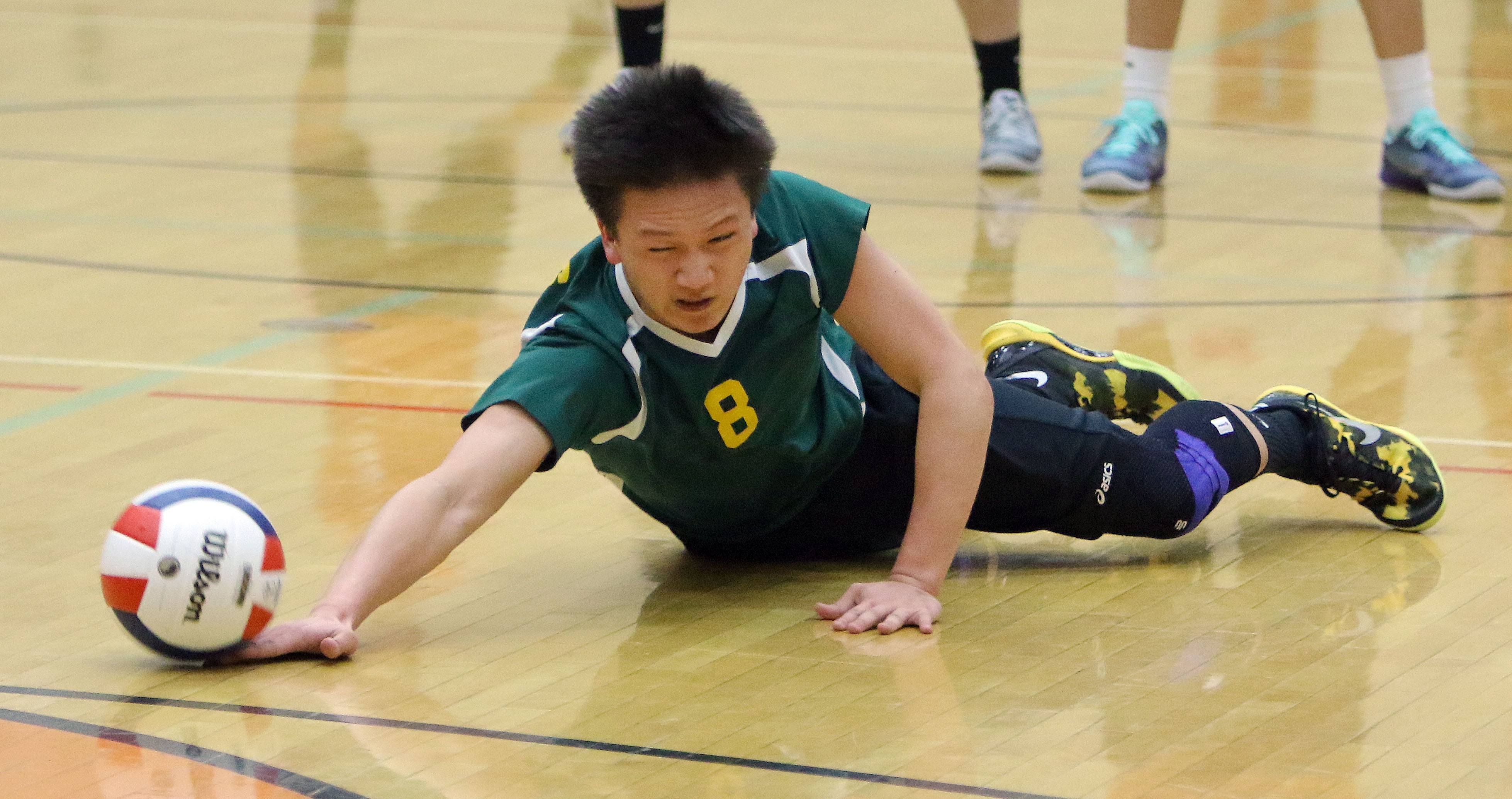 Stevenson's Jeffrey Wang dives for a loose ball Wednesday at Libertyville High School.