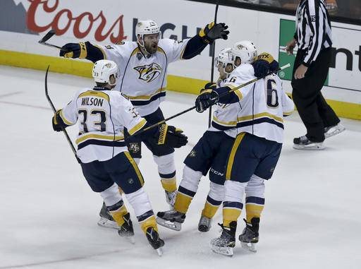 Nashville Predators center Paul Gaustad (28) celebrates with teammates after scoring during the first period of Game 7 in an NHL hockey Stanley Cup playoffs first-round series against the Anaheim Ducks in Anaheim, Calif., Wednesday, April 27, 2016. (AP Photo/Chris Carlson)