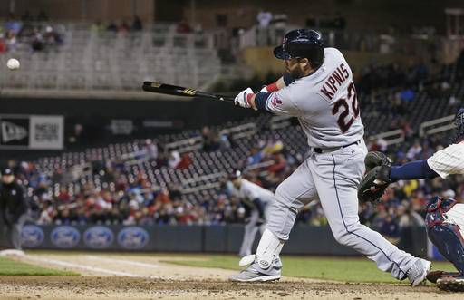 Cleveland Indians' Jason Kipnis hits an RBI single to tie the baseball game off Minnesota Twins pitcher Jose Berrios in the fifth inning of a baseball game Wednesday, April 27, 2016, in Minneapolis. (AP Photo/Jim Mone)