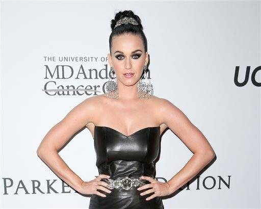 "FILE - In this April 13, 2016 file photo, Katy Perry arrives at Sean Parker and the Parker Foundation's Gala Celebrating a Milestone in Medical Research in Los Angeles. Perry will perform at amfAR's annual ""Cinema Against AIDS"" event, the glitzy A-list fundraiser held annually during the Cannes Film Festival. The May 19th event raises money to for AIDS research. (Photo by Rich Fury/Invision/AP, File)"