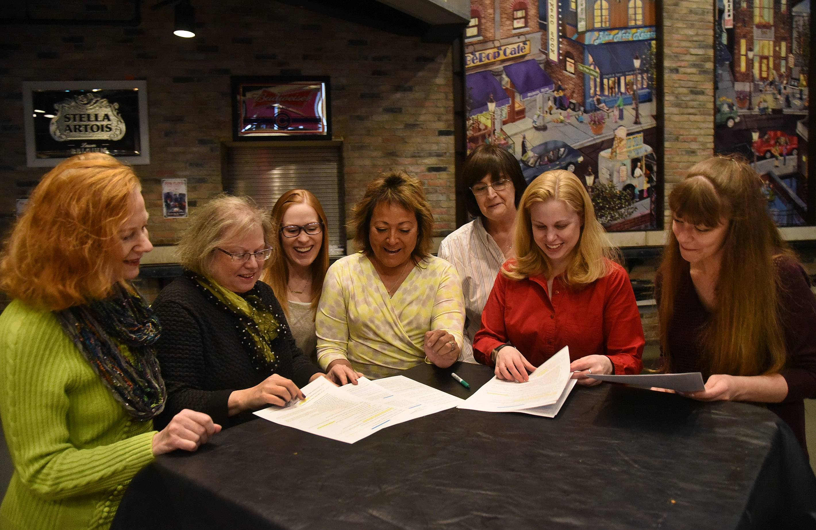From left, Jacqui Neurauter, Linda Schneider, Nicole Nicioli, Margo Gomez-Berzins, Rana Michaels and Michelle Kukla talk over the agenda for their Empowerment Summit with Jamie Barr, director of marketing and events for Durty Nellie's.