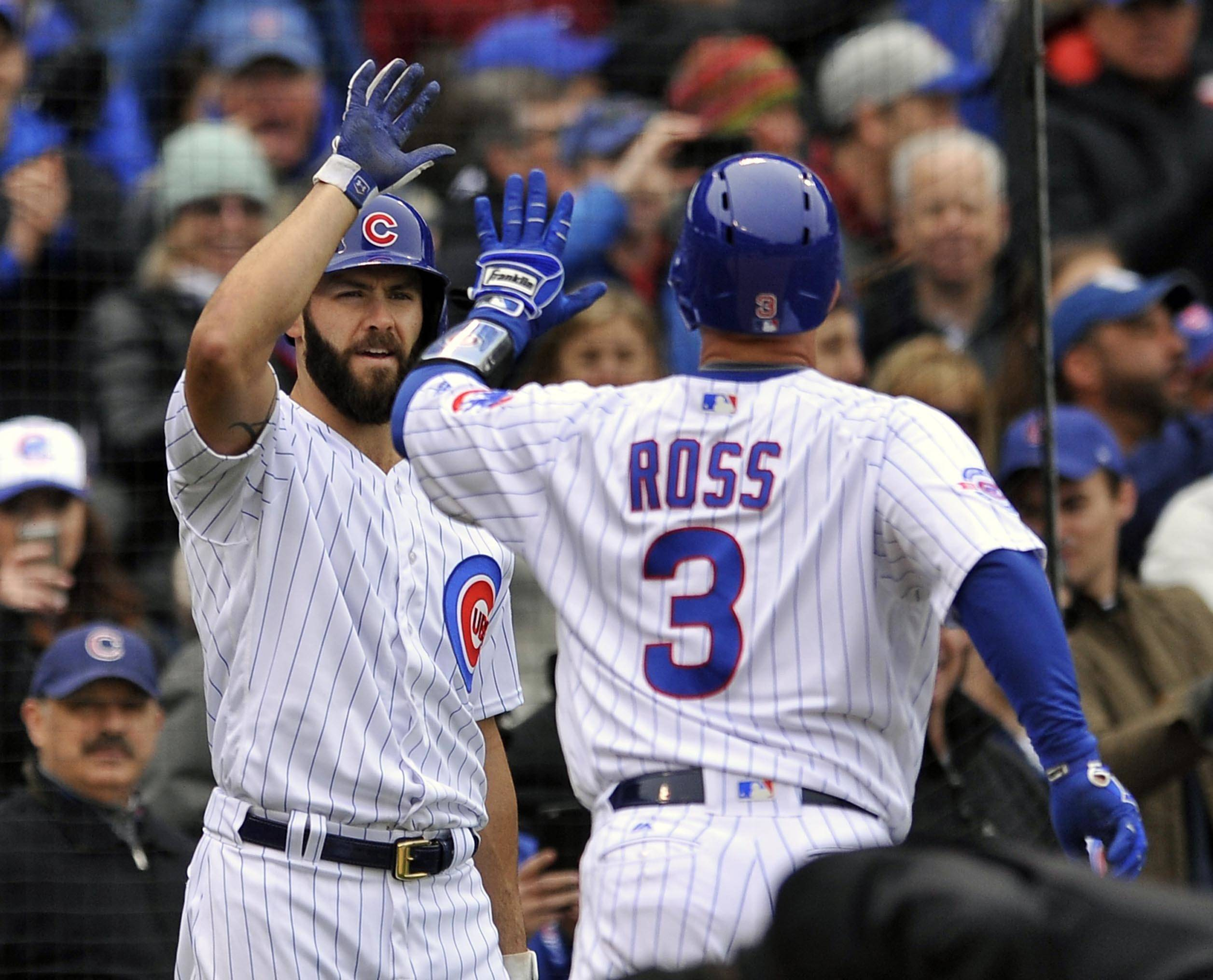 Chicago Cubs catcher David Ross (3) celebrates with teammate Jake Arrieta after hitting a solo home run during the second inning against the Milwaukee Brewers on Thursday in Chicago.
