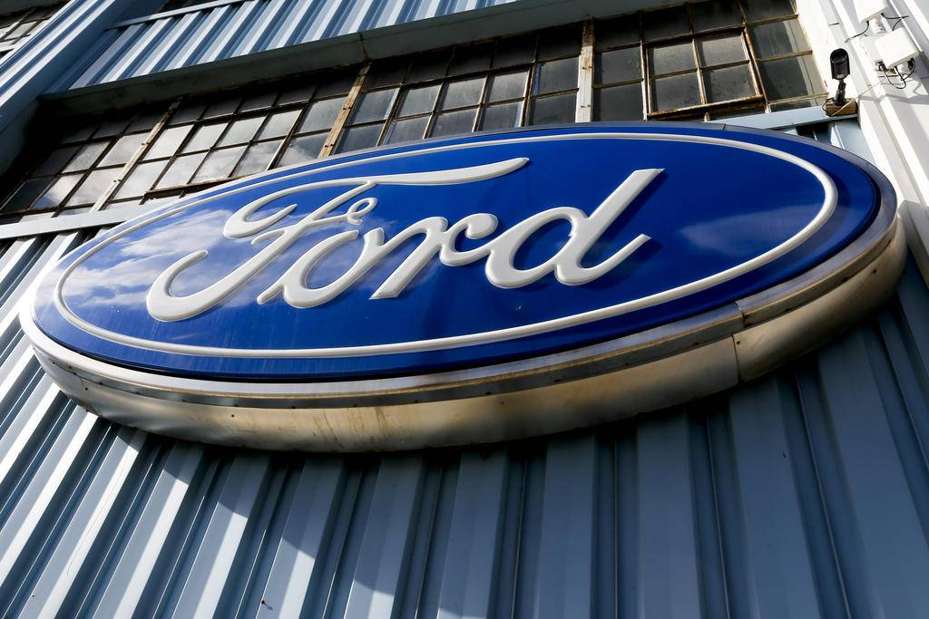 This Thursday, Nov. 19, 2015, photo, shows a Ford sign above the entrance to Butler County Ford in Butler, Pa. Ford reports financial results Thursday, April 28, 2016. (AP Photo/Keith Srakocic)