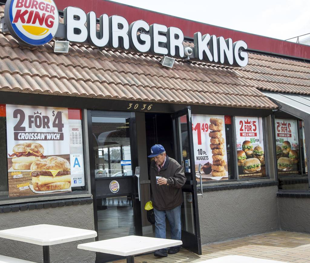 FILE - In this Wednesday, March 18, 2015, file photo, food specials are offered at a Burger King fast food restaurant in Los Angeles. On Thursday, April 28, 2016, Burger King owner Restaurant Brands International Inc. reports earnings. (AP Photo/Damian Dovarganes, File)