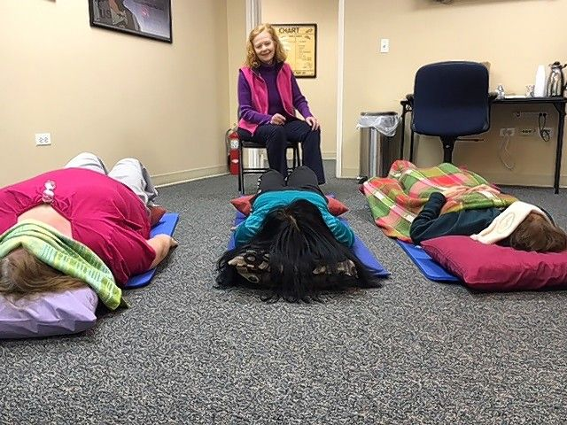 Jacqui Neurauter does iRest guided meditation during a previous Empowerment Summit in Joliet.