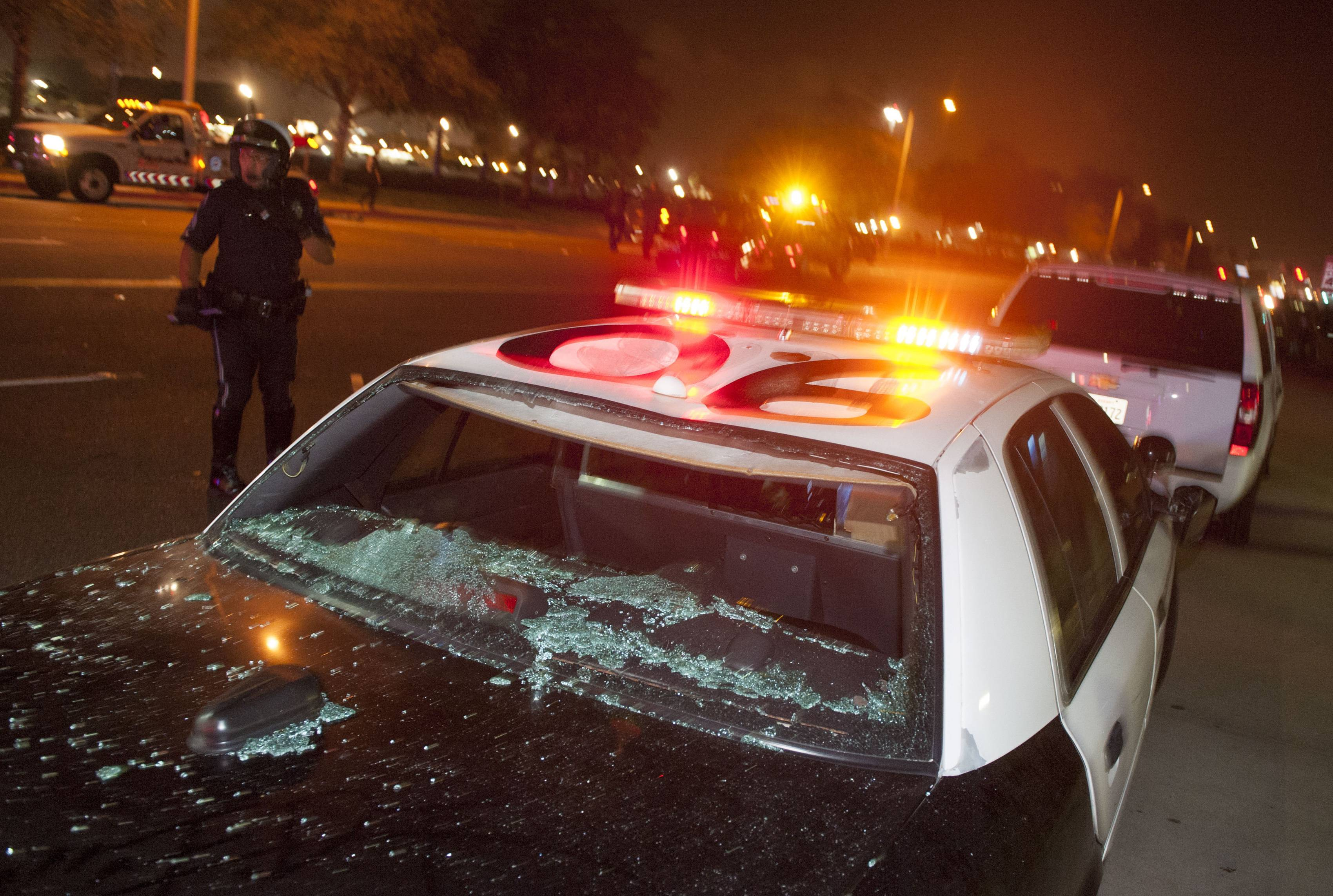A damaged Costa Mesa Police cruiser sits at the corner of Fair Drive and Fairview Road near the OC Fairgrounds where Donald Trump spoke earlier Thursday in Costa Mesa, Califorinia.
