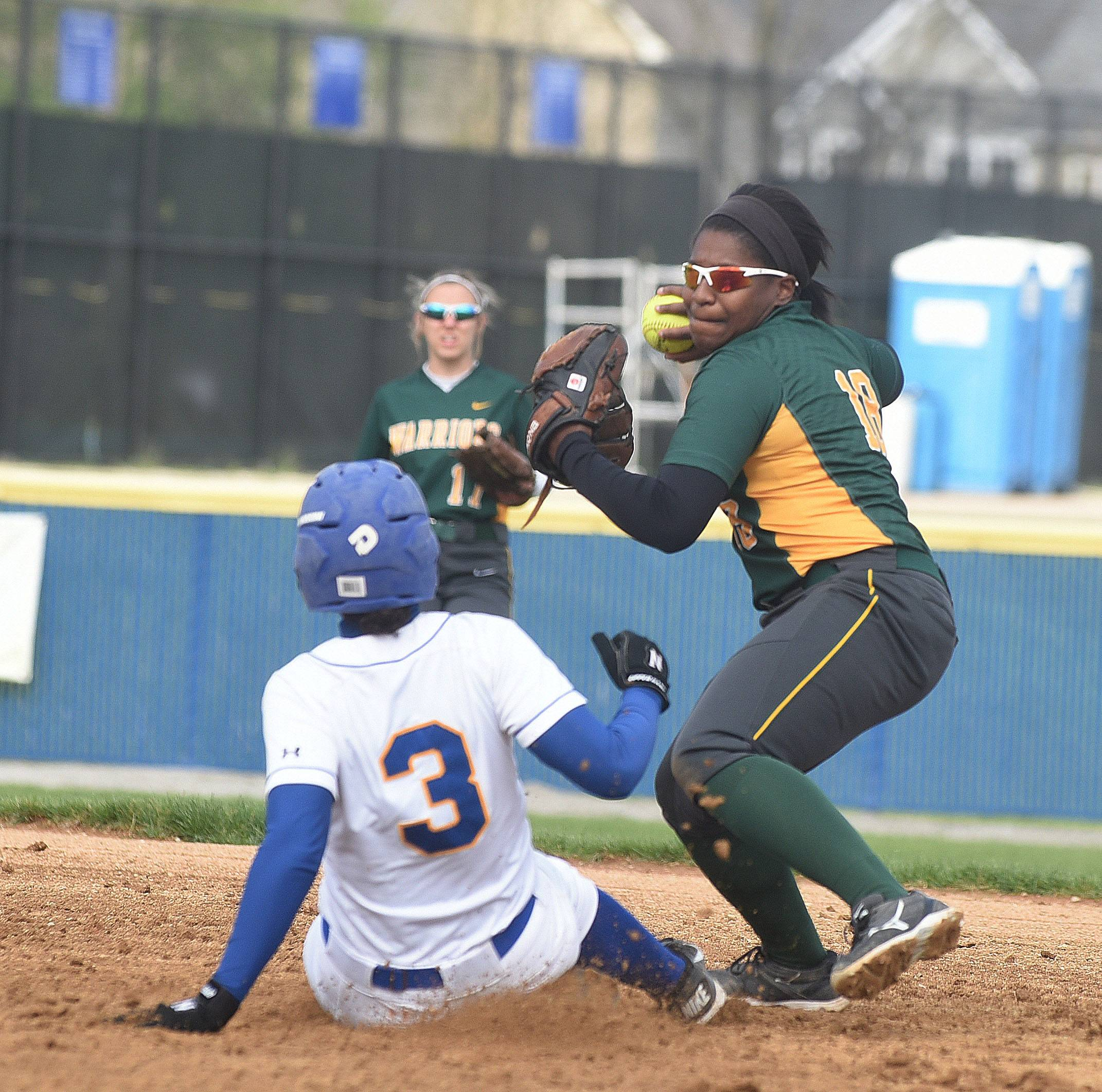 Alleigha Burau of Wheaton North slides into second as Kiara Bryant of Waubonsie makes the throw to first during the Waubonsie Valley at Wheaton North softball game Friday.