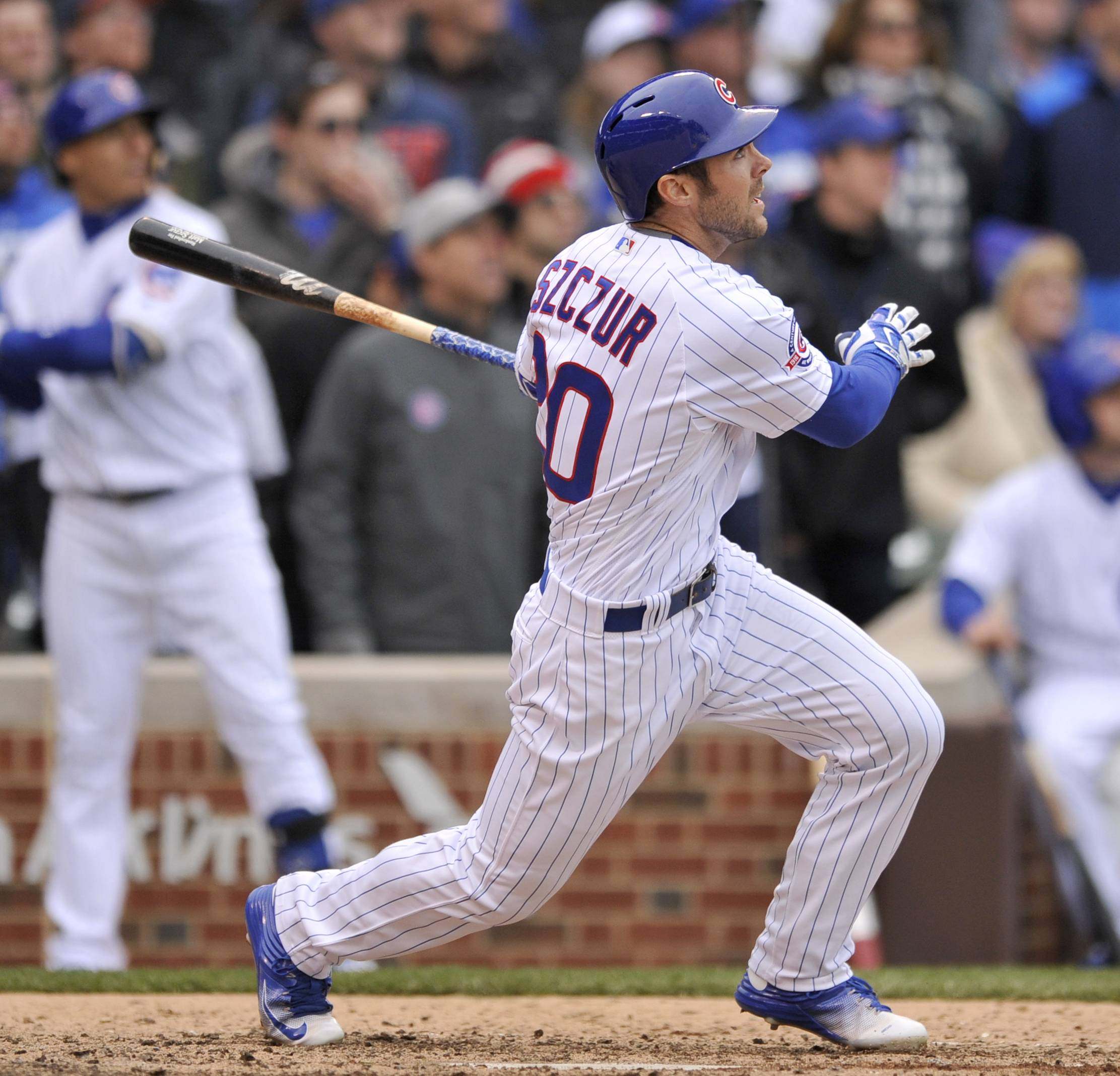 Matt Szczur hit his first career grand slam during a five-run eighth inning and the Chicago Cubs broke away from the Atlanta Braves 6-1 Friday at Wrigley Field.