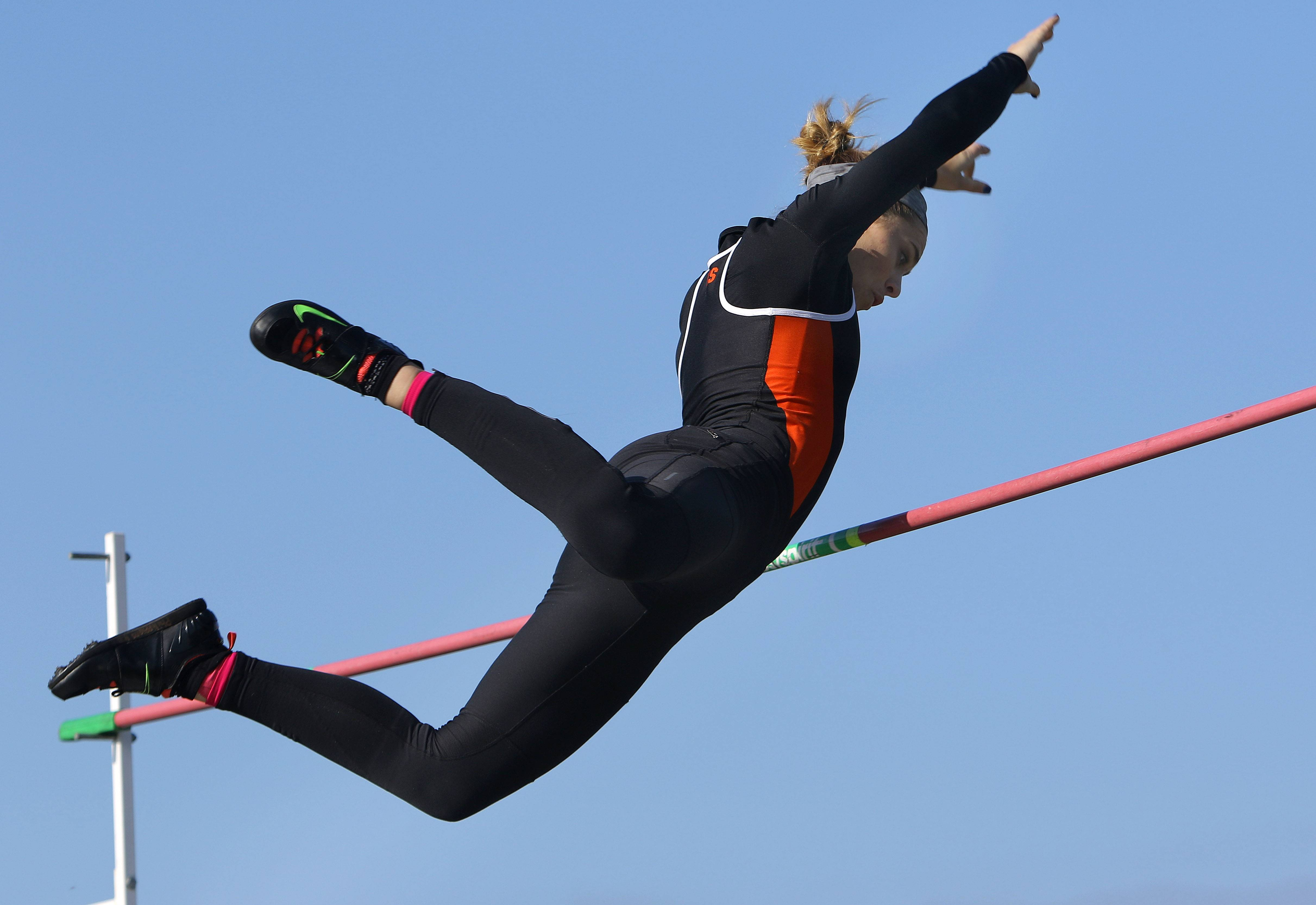 Libertyville's Lily Moore competes in the pole vault during the Lake County meet Friday at Grayslake North High School.