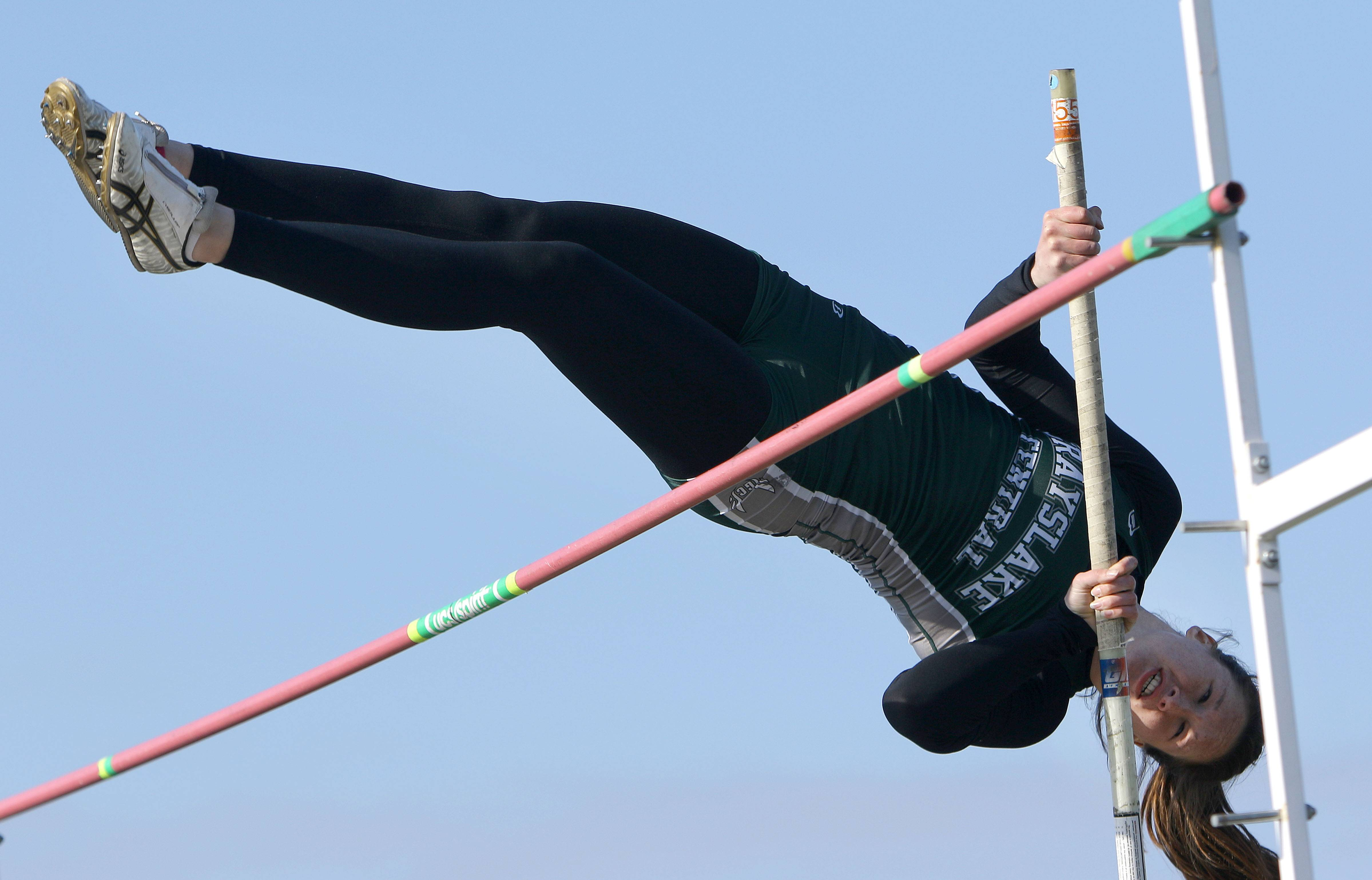 Grayslake Central's Katie Schroeder competes in the pole vault during the Lake County meet Friday at Grayslake North High School.