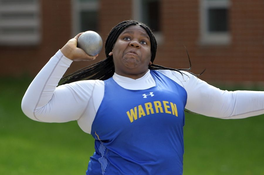 Warren's Abena Atuobi throws the shot put during the Lake County meet Friday at Grayslake North High School.