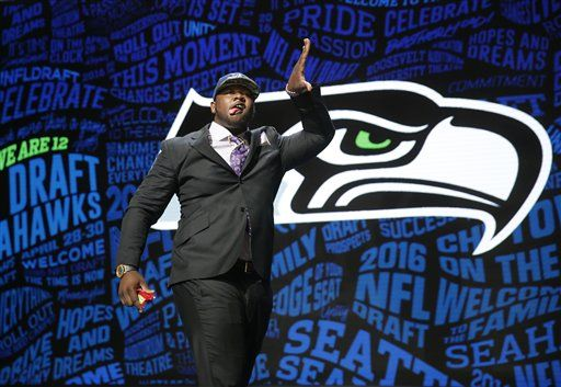 Alabama's Jarran Reed celebrates after being selected by the Seattle Seahawks as the 49th pick in the second round of the 2016 NFL football draft, Friday, April 29, 2016, in Chicago.