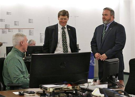Green Bay Packers general manager Ted Thompson, left, president Mark Murphy, center, and head coach Mike McCarthy talk inside the war room during the 2016 NFL Football draft at Lambeau Field in Green Bay, Wis., on Thursday, April 28, 2016. (Evan Siegle/The Green Bay Press-Gazette via AP) NO SALES; MANDATORY CREDIT