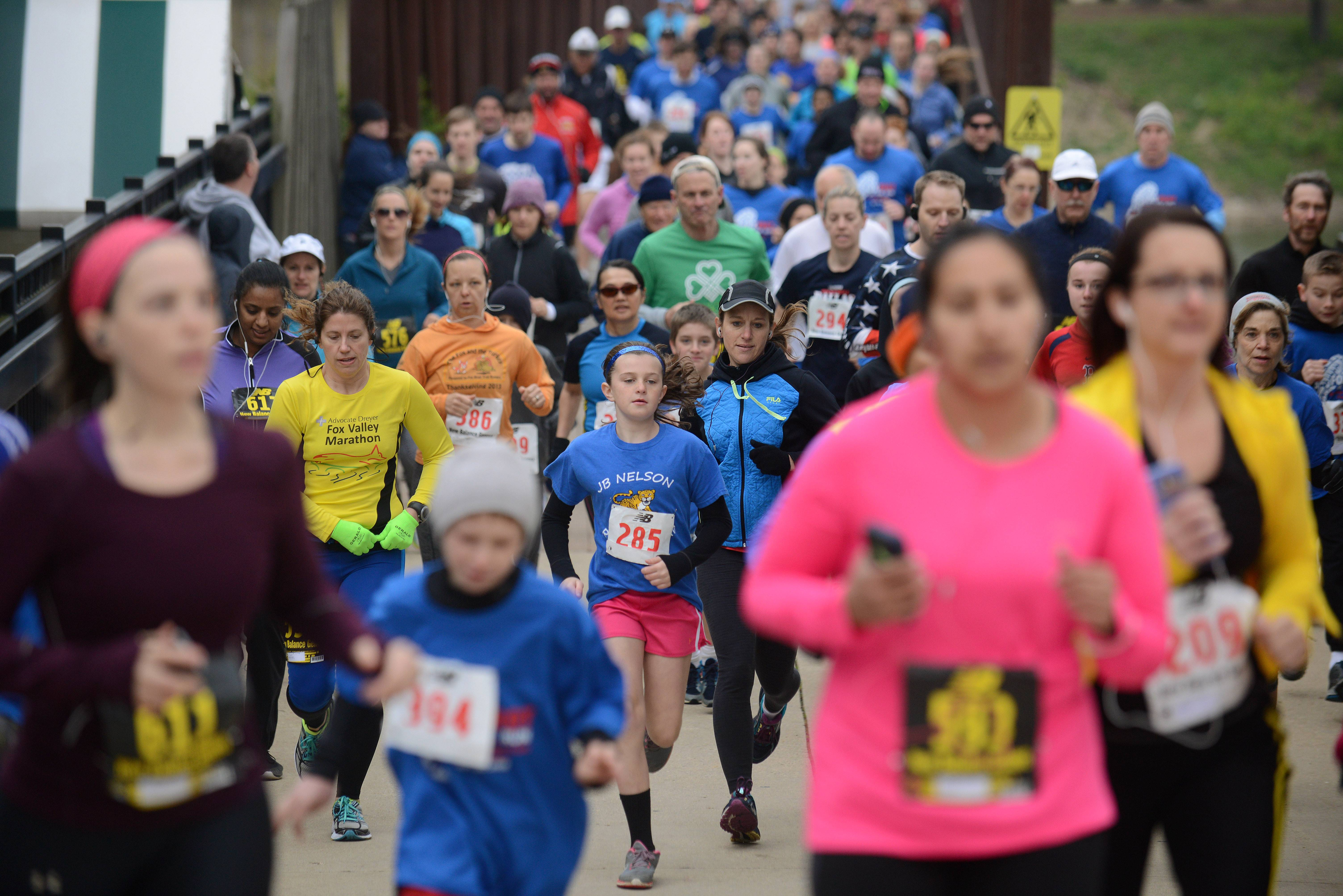 Laura Stoecker/lstoecker@dailyherald.com The Batavia Mothers' Club Foundation's 16th annual Fox Trot 5K and 10K races in Batavia Saturday attracted more than 325 runners of all ages.